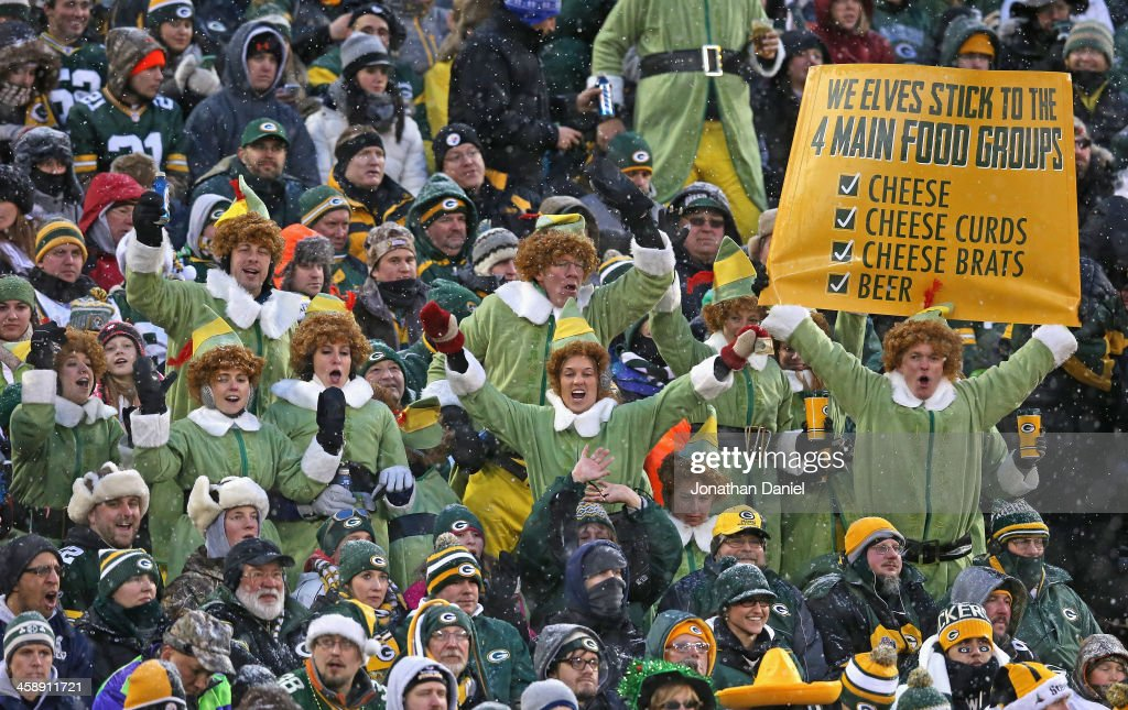 Fans of the Green Bay Packers dressed as elves enjoy a game between the Packers and the Pittsburgh Steelers at Lambeau Field on December 22, 2013 in Green Bay, Wisconsin.