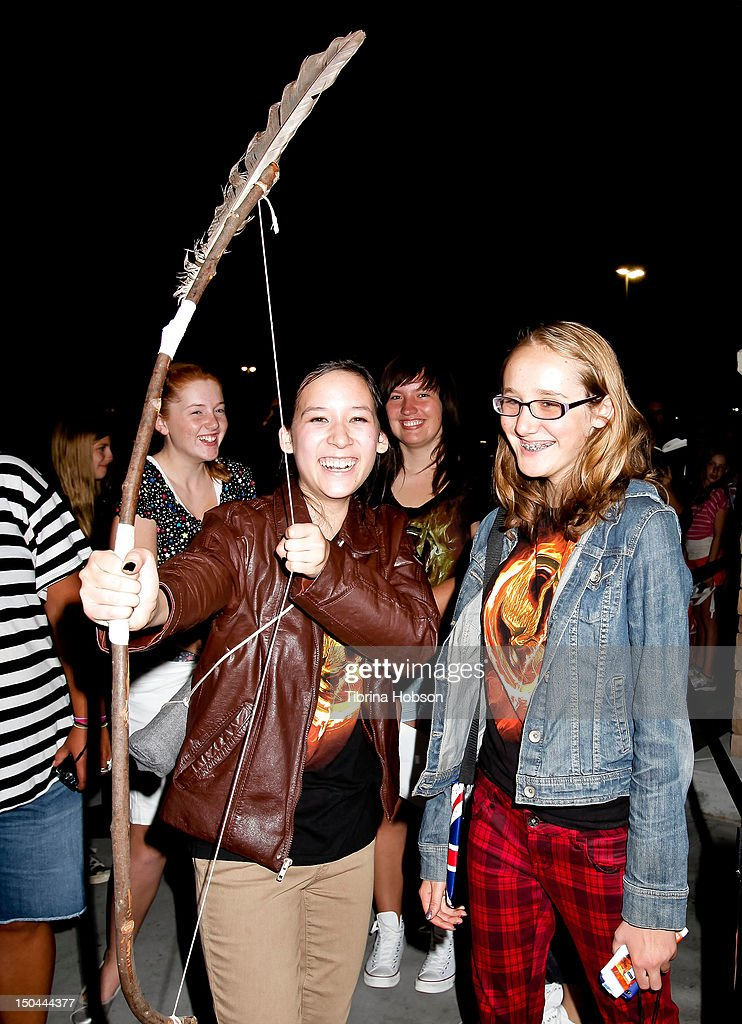 Fans of 'The Hunger Games' Jenna Lui and Anneliese Gelberg attend Lionsgate's 'The Hunger Games' blu-ray disc and DVD release and fan signing at Walmart on August 17, 2012 in Santa Clarita, California.