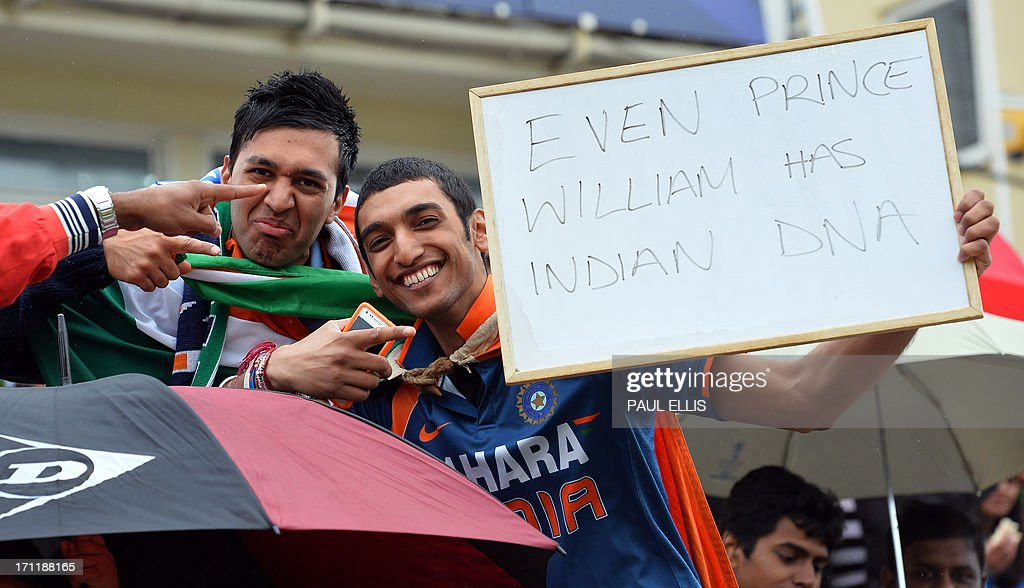 Fans of the Indian cricket team, hold up a message they wait for the start of the 2013 ICC Champions Trophy Final cricket match between England and India at Edgbaston in Birmingham, central England on June 23, 2013.