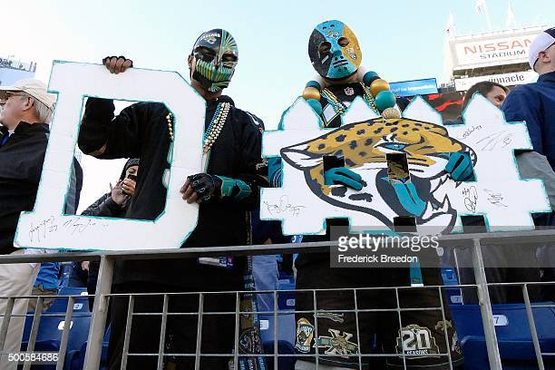 Fans of the Jacksonville Jaguars hold up a defense sign during a game against the Tennessee Titans at Nissan Stadium on December 6 2015 in Nashville...