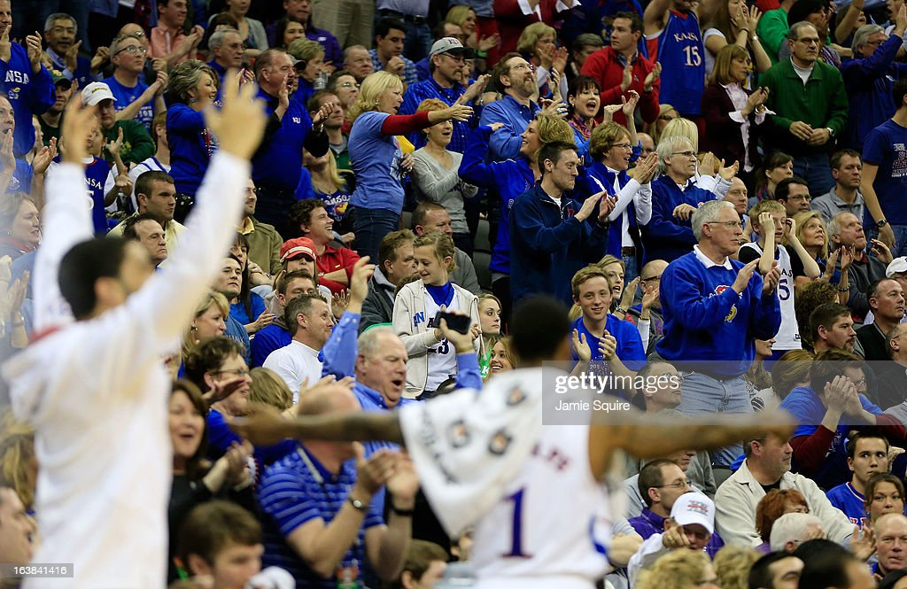 Fans of the Kansas Jayhawks celebrate in the second half of the game against Kansas State Wildcats during the Final of the Big 12 basketball tournament at Sprint Center on March 16, 2013 in Kansas City, Missouri.