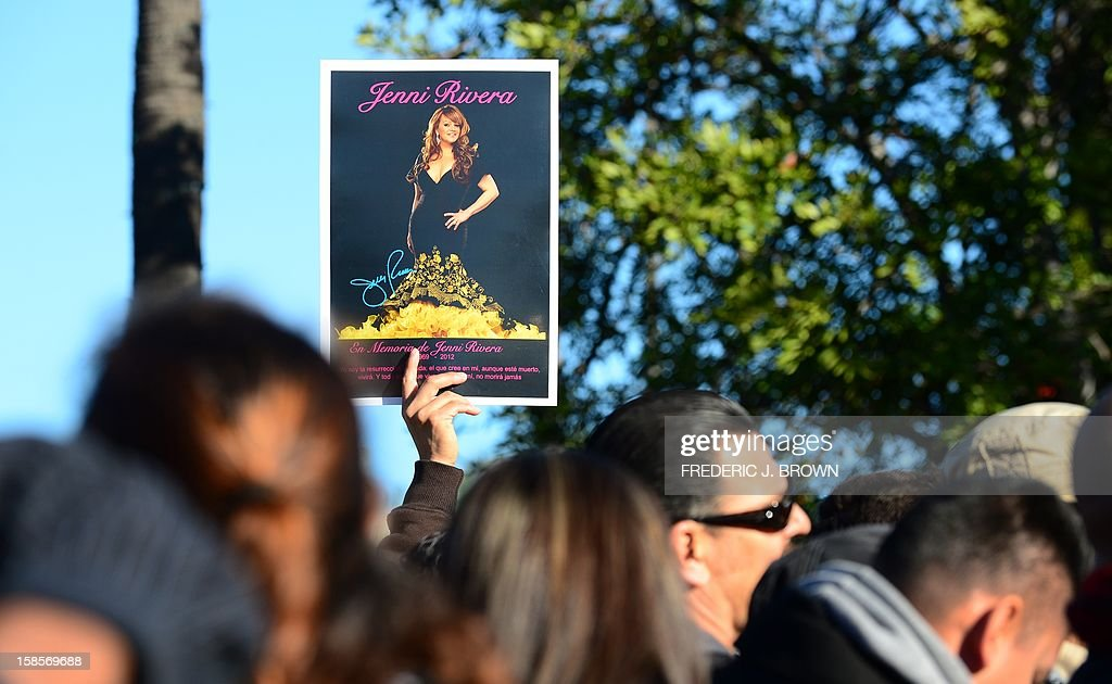 Fans of the late Mexican-American singer Jenni Rivera wait to attend the memorial service at the Gibson Amphitheater in Universal City on December 19, 2012 in California. The service, billed by the Rivera family as a 'Celestial Graduation,'' was broadcast live and watched by her many fans off a big screen at a Universal CityWalk plaza. AFP PHOTO / Frederic J. BROWN