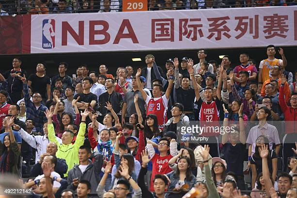 Fans of the Los Angeles Clippers cheers against the Charlotte Hornets as part of the 2015 NBA Global Games China at the Shenzhen Universiade Center...