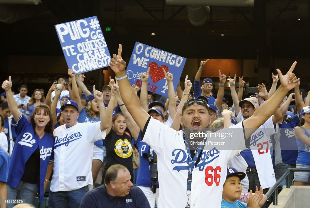 Fans of the Los Angeles Dodgers celebrate after defeating the Arizona Diamondbacks to clinch the National League West title and a postseason berth at Chase Field on September 19, 2013 in Phoenix, Arizona.