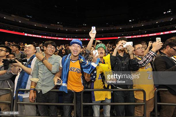 Fans of the Los Angeles Lakers cheers against the Golden State Warriors during the 2013 Global Games on October 18 2013 at the MercedesBenz Arena in...
