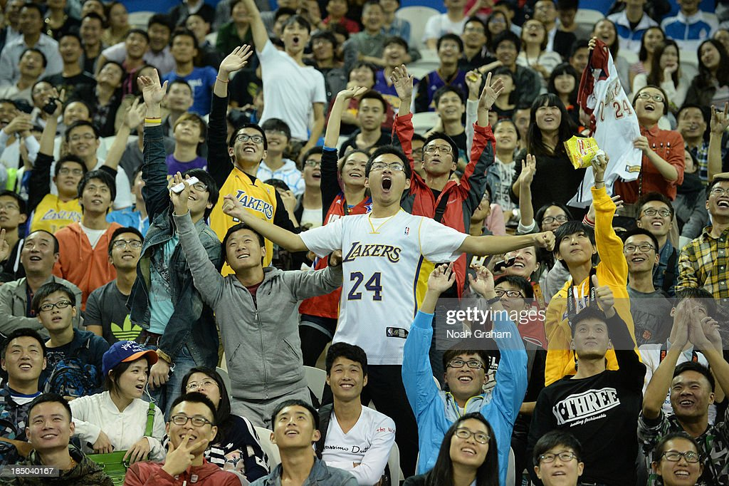 Fans of the Los Angeles Lakers cheers during Fan Appreciation Day as part of the 2013 Global Games on October 17, 2013 at the Oriental Sports Center in Shanghai, China.