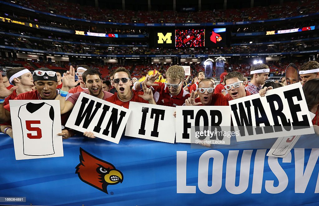 Fans of the Louisville Cardinals holds up signs in support of injured guard Kevin Ware of the Louisville Cardinals prior to Louisville playing...