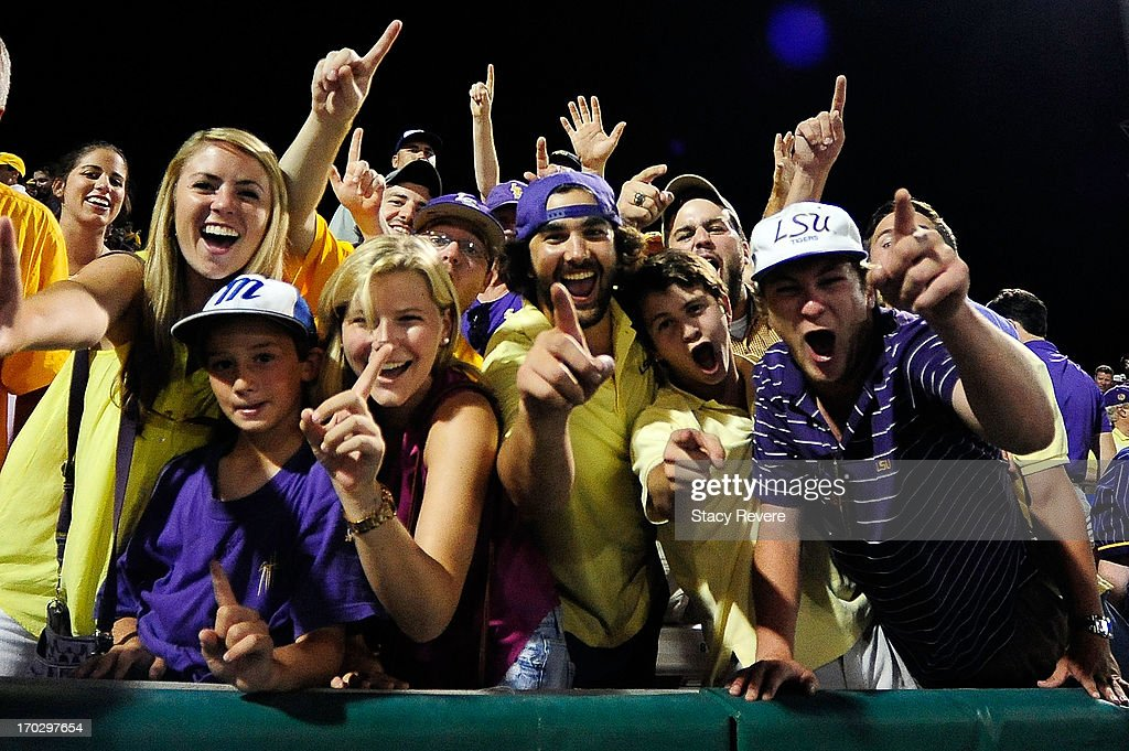 Fans of the LSU Tigers celebrate a victory over the Oklahoma Sooners following game 2 of the NCAA baseball Super Regionals at Alex Box Stadium on June 8, 2013 in Baton Rouge, Louisiana.