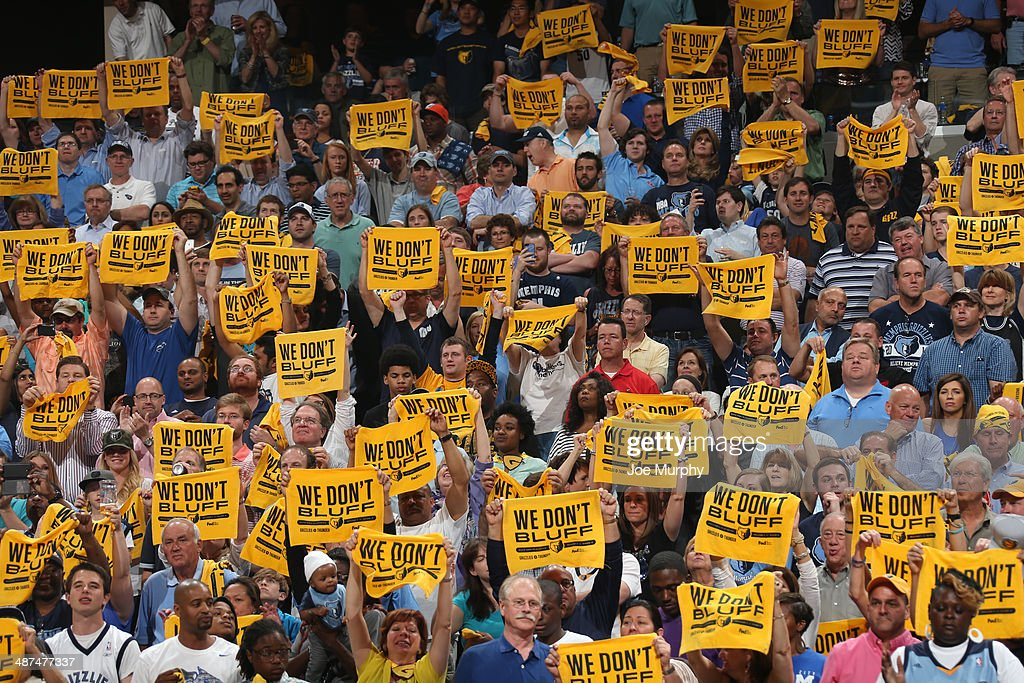 Fans of the Memphis Grizzlies hold up towels with the theme 'We Don't Bluff' during the game against the Oklahoma City Thunder in Game Four of the Western Conference Quarterfinals during the 2014 NBA Playoffs on April 26, 2014 at FedExForum in Memphis, Tennessee.
