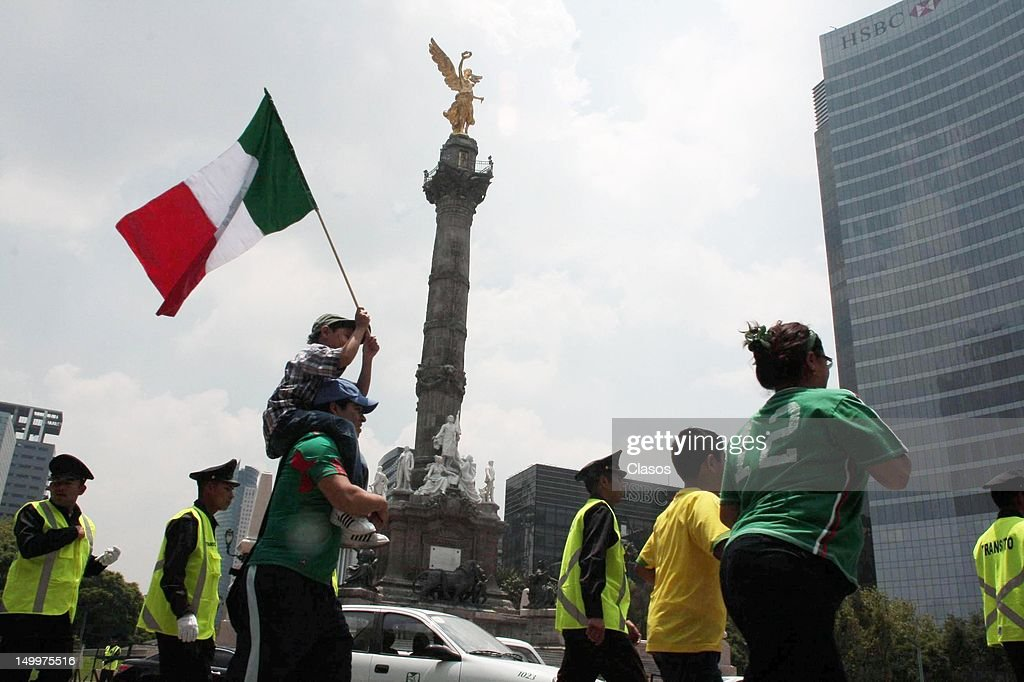 Fans of the Mexican National Team Mexico celebrate the victory over Japan in soccer in the Olympic Games London 2012 at the Glorieta del Angel of Independence, on August 07, 2012, in Mexico City, Mexico.