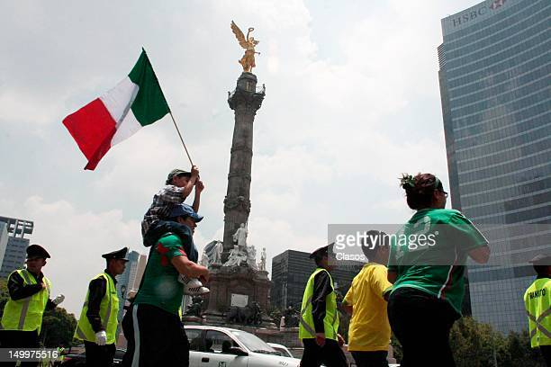 Fans of the Mexican National Team Mexico celebrate the victory over Japan in soccer in the Olympic Games London 2012 at the Glorieta del Angel of...