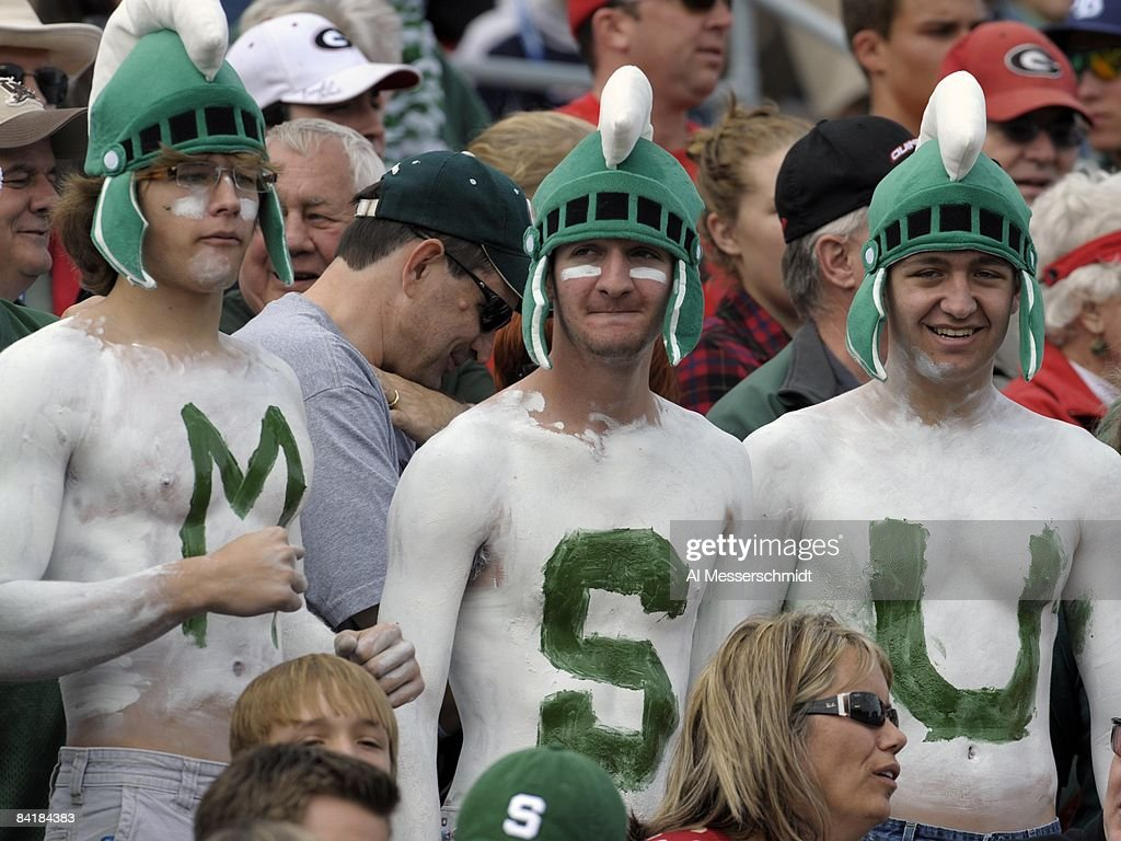 Fans of the Michigan State Spartans cheer play against the Georgia Bulldogs at the 2009 Capital One Bowl at the Citrus Bowl on January 1 2009 in...