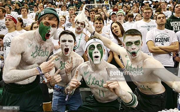 Fans of the Michigan State Spartans get ready to cheer on their team during the game against the Michigan Wolverines at Breslin Center on January 25...