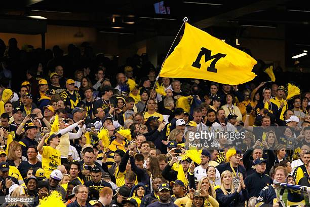 Fans of the Michigan Wolverines support their school against the Virginia Tech Hokies during the Allstate Sugar Bowl at MercedesBenz Superdome on...