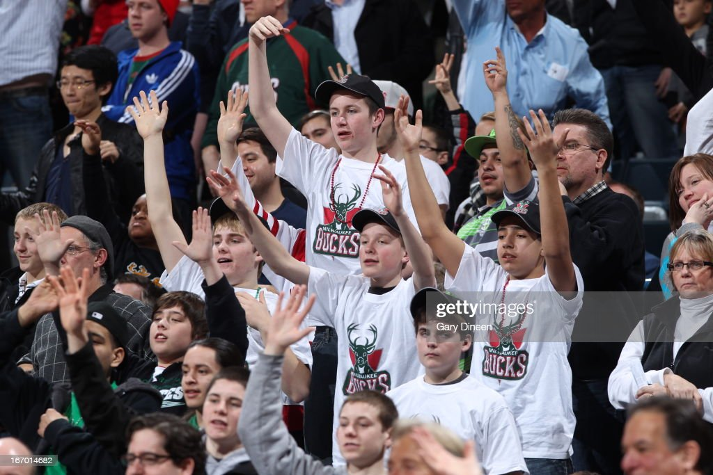 Fans of the Milwaukee Bucks get pumped up while watching the game against the Portland Trail Blazers on March 19, 2013 at the BMO Harris Bradley Center in Milwaukee, Wisconsin.