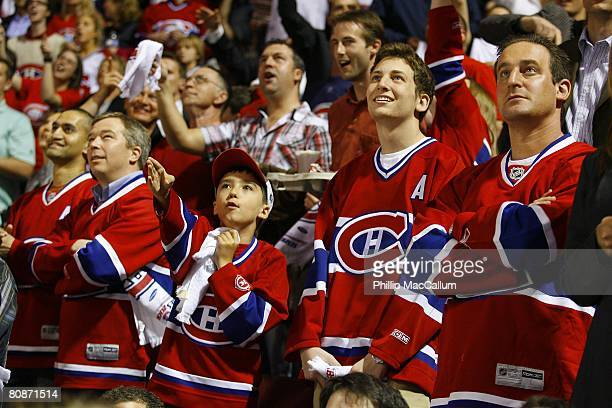 Fans of the Montreal Canadiens cheer as they watch the monitor during Game One of the Eastern Conference Semifinals of the 2008 NHL Stanley Cup...
