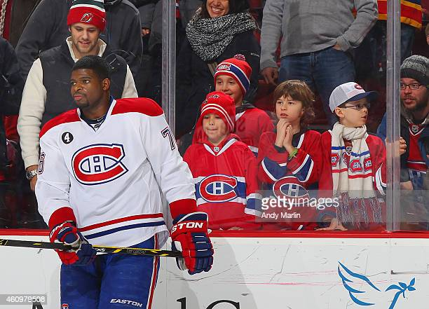 Fans of the Montreal Canadiens watch PK Subban and pregame warmups prior to the game against the New Jersey Devils during at the Prudential Center on...