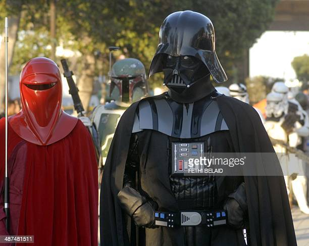 Fans of the movie franchise Star Wars dressed as their favourite movie character pose for a picture on April 30 2014 on Avenue Habib Bourguiba in...