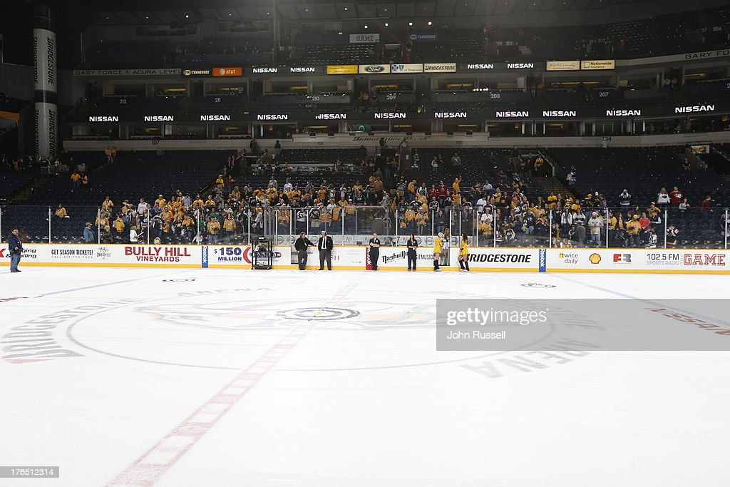 Fans of the Nashville Predators take their rink-side seats before their team battles against the Minnesota Wild during an NHL game at the Bridgestone Arena on March 9, 2013 in Nashville, Tennessee.