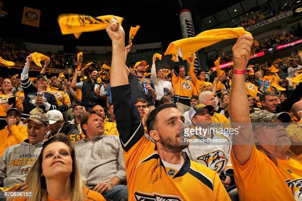 Fans of the Nashville Predators wave rally towels during the first period in Game Four of the Western Conference First Round against the Chicago...