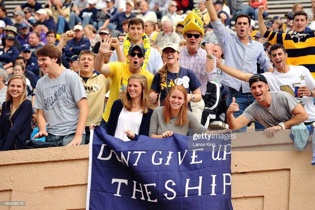 Fans of the Navy Midshipmen cheer on their team against the Duke Blue Devils at Wallace Wade Stadium on October 12, 2013 in Durham, North Carolina. Duke defeated Navy 35-7.