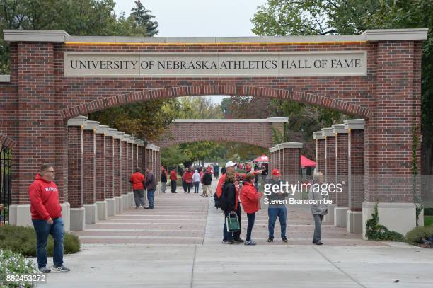 Fans of the Nebraska Cornhuskers walk through the Athletics Hall of Fame display before the game against the Ohio State Buckeyes at Memorial Stadium...