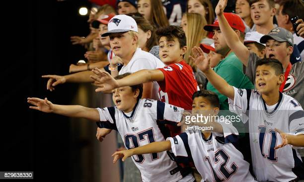 Fans of the New England Patriots react after a preseason game against the Jacksonville Jaguars at Gillette Stadium on August 10 2017 in Foxboro...