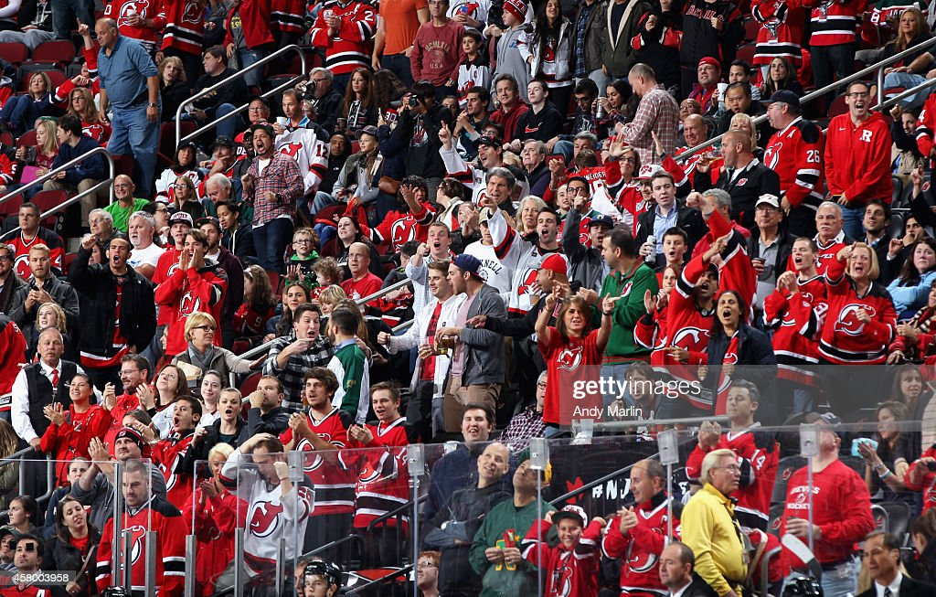 Fans of the New Jersey Devils cheer a Devil goal during the game against the Dallas Stars at the Prudential Center on October 24 2014 in Newark New...