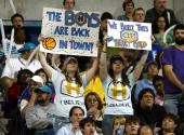 Fans of the New Orleans/Oklahoma City Hornets hold up signs during a game against the Los Angeles Lakers welcoming them back for the first time in...