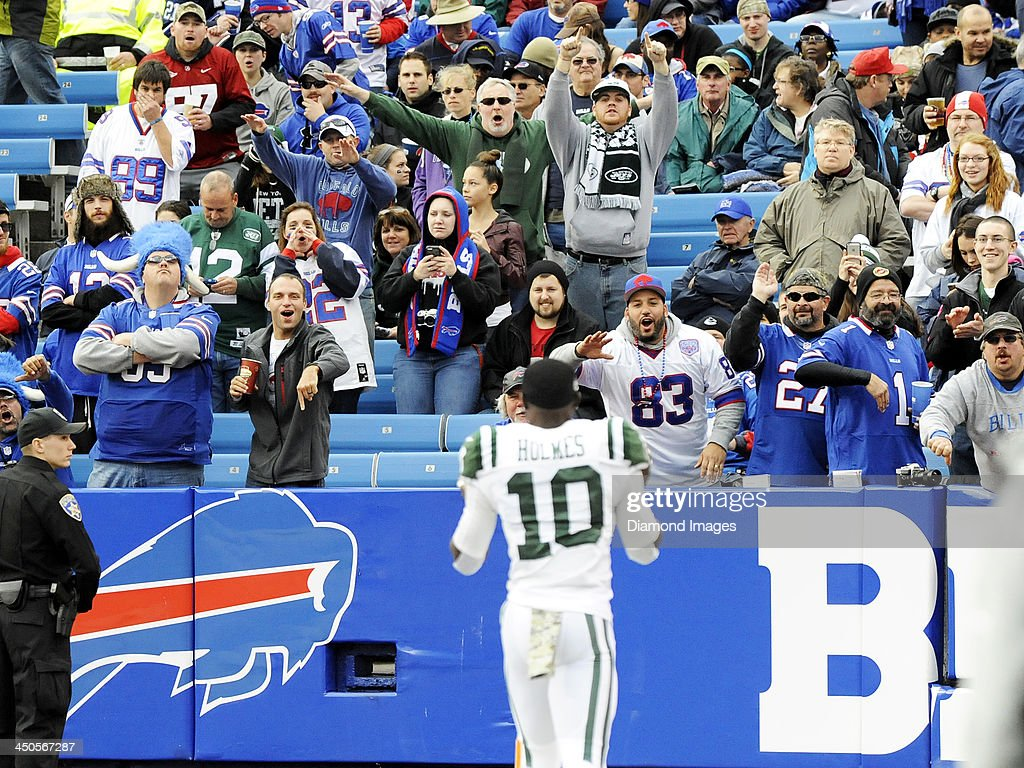 Fans of the New York Jets and Buffalo Bills yells toward wide receiver Santonio Holmes #10 of the New York Jets as he approaches them prior to a game at Ralph Wilson Stadium in Orchard Park, New York on November 17, 2013. Buffalo won 37-14.