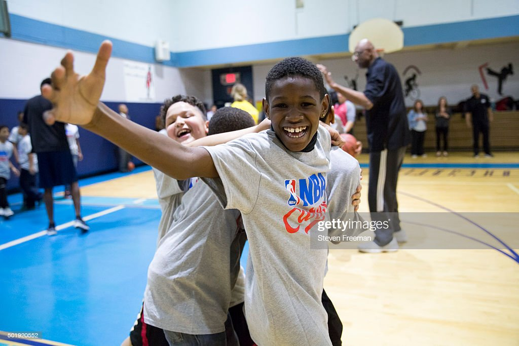 Fans of the New York Knicks and the Miami Heat participates at an NBA Cares clinic for Good Morning America at the Madison Square Boys and Girls Club on December 12, 2015 in Bronx, New York.