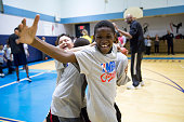 Fans of the New York Knicks and the Miami Heat participates at an NBA Cares clinic for Good Morning America at the Madison Square Boys and Girls Club...