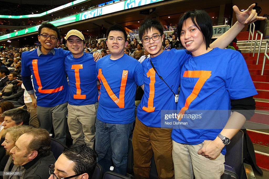 Fans of the New York Knicks wearing Lin #17 shirts pose during game against the Washington Wizards at the Verizon Center on February 8, 2012 in Washington, DC.