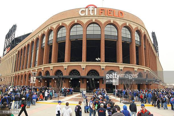 Fans of the New York Mets wait to enter the stadium to watch the Mets' home opener against the Washington Nationals at Citi Field on April 8 2011 in...