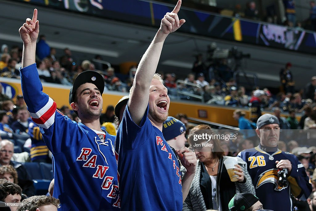 Fans of the New York Rangers cheer during the game against the Buffalo Sabres at First Niagara Center on April 19, 2013 in Buffalo, New York.
