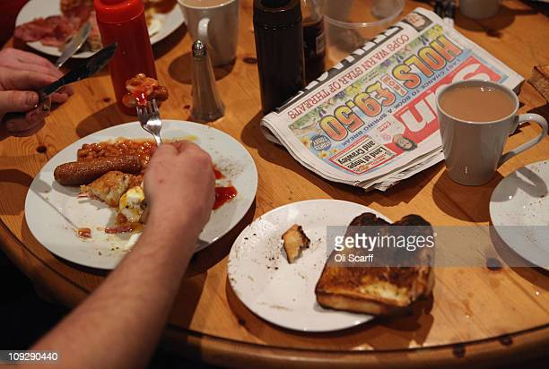 Fans of the nonleague football club Crawley Town enjoy breakfast at the Pelham Buckle pub before boarding coaches to Manchester to watch their team...