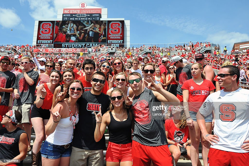Fans of the North Carolina State Wolfpack cheer on their team during a game against the Louisiana Tech Bulldogs at Carter-Finley Stadium on August 31, 2013 in Raleigh, North Carolina.