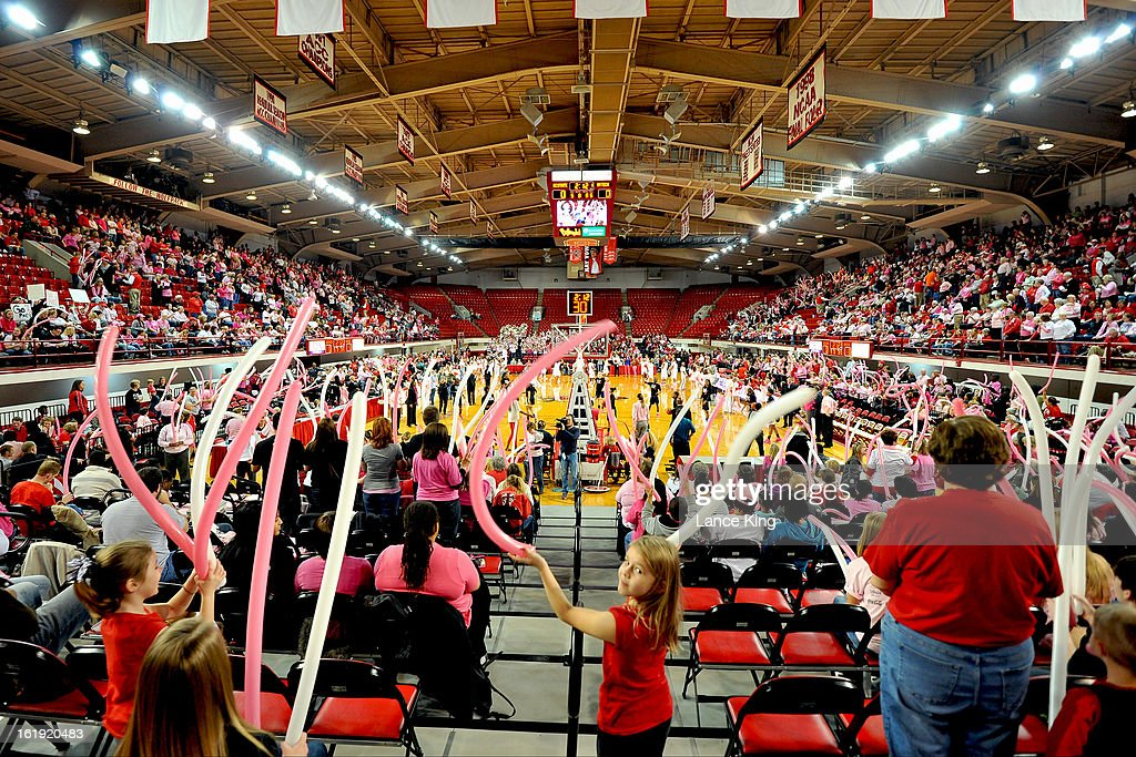 Fans of the North Carolina State Wolfpack cheer prior to their game against the Georgia Tech Yellow Jackets at Reynolds Coliseum on February 17, 2013 in Raleigh, North Carolina.