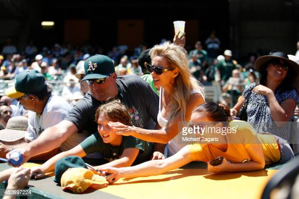 Fans of the Oakland Athletics clamor for autographs prior to the game against the Toronto Blue Jays at Oco Coliseum on July 6 2014 in Oakland...