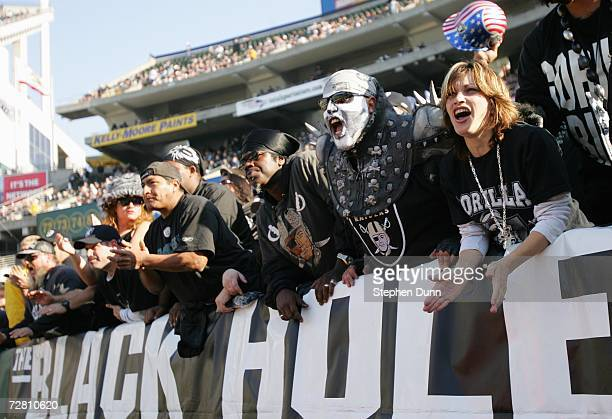 Fans of the Oakland Raiders cheers against the Houston Texans during the game on December 3 2006 at McAfee Coliseum in Oakland California