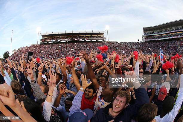 Fans of the Ole Miss Rebels rush the field to celebrate the victory over the Alabama Crimson Tide on October 4 2014 at VaughtHemingway Stadium in...