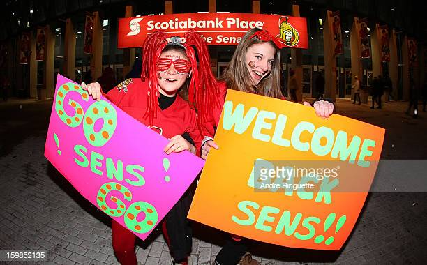 Fans of the Ottawa Senators welcome back their team before a game against the Florida Panthers on January 21 2013 at Scotiabank Place in Ottawa...