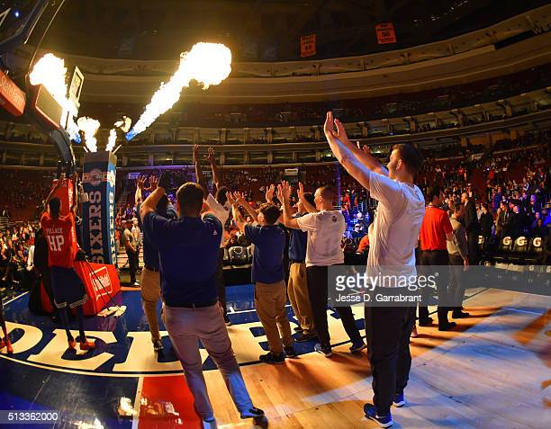 Fans of the Philadelphia 76ers keep warm during player announcements against the Charlotte Hornets at Wells Fargo Center on March 2 2016 in...
