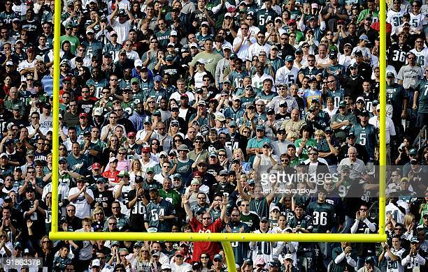 Fans of the Philadelphia Eagles cheer from the stands during a game against the Tampa Bay Buccaneers at Lincoln Financial Field on October 11 2009 in...