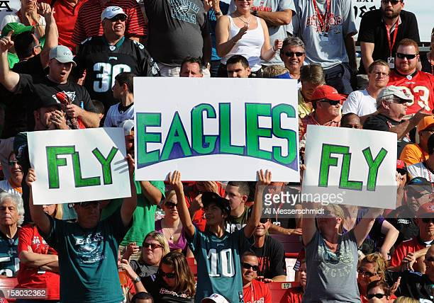 Fans of the Philadelphia Eagles cheer play against the Tampa Bay Buccaneers December 9 2012 at Raymond James Stadium in Tampa Florida