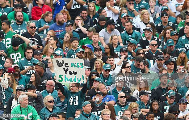 Fans of the Philadelphia Eagles hold a sign that reads 'We Miss You Shady' during the game against the Buffalo Bills during the second quarter at...