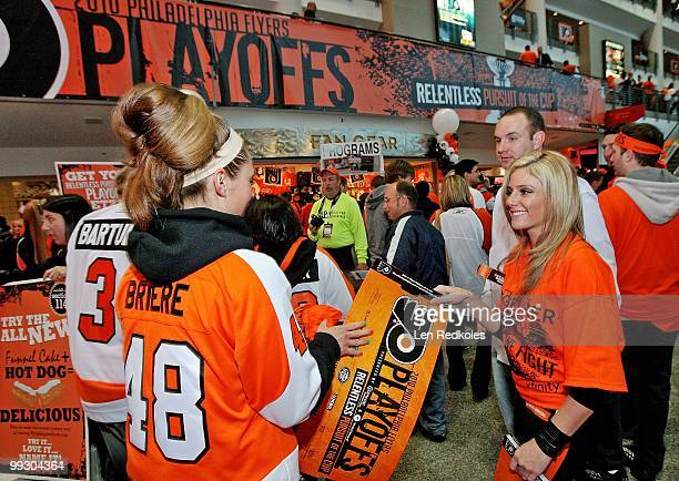 Fans of the Philadelphia Flyers are given playoff cards as they enter the building prior to the game against the Boston Bruins in Game Six of the...
