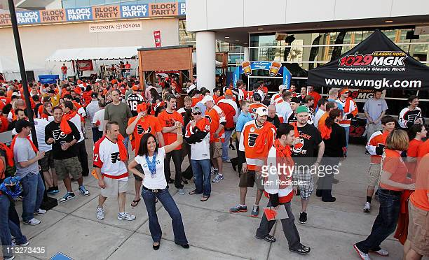 Fans of the Philadelphia Flyers arrive at an outdoor block party in support of their team before the game against the Buffalo Sabres in Game Seven of...