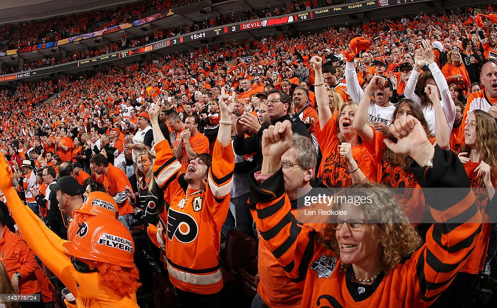 Fans of the Philadelphia Flyers celebrate a third period goal against the New Jersey Devils in Game One of the Eastern Conference Semifinals during...