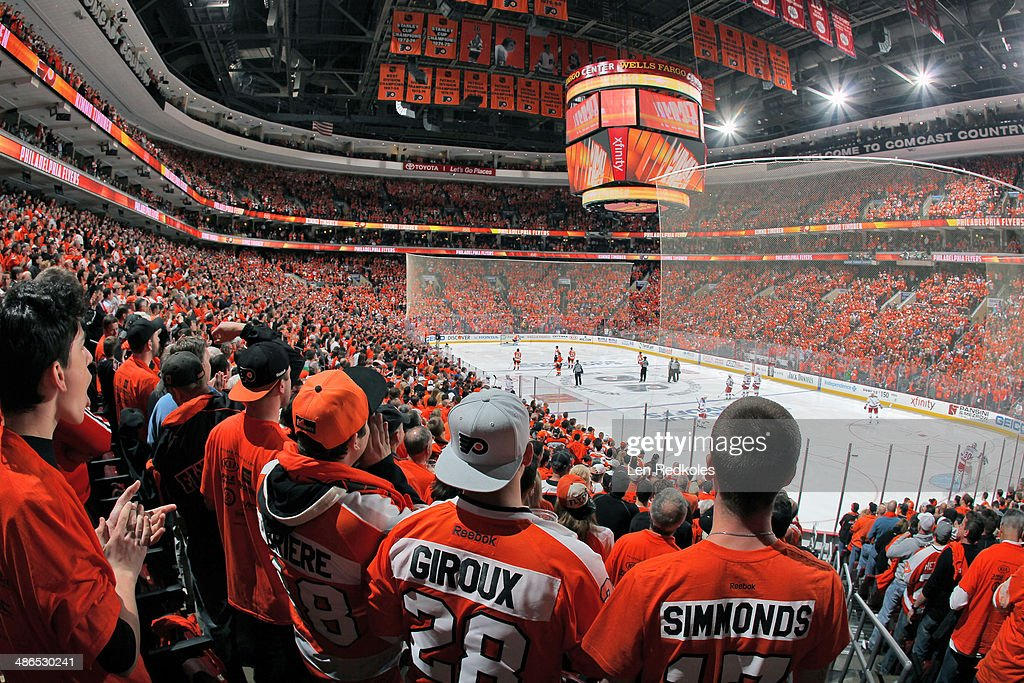 Fans of the Philadelphia Flyers cheer their team on at the start of Game Three of the First Round of the 2014 Stanley Cup Playoffs against the New...